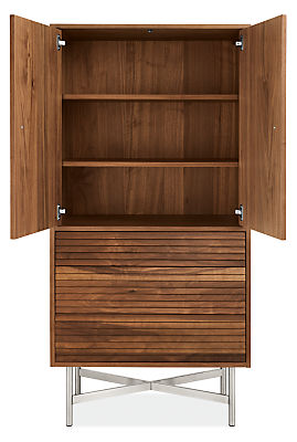 Detail of large Adrian storage cabinet with doors open