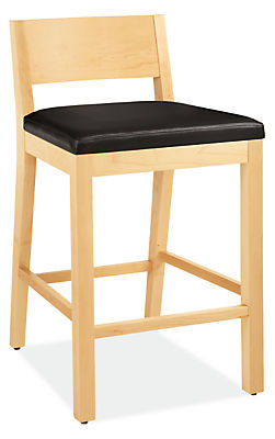 Angle view of Afton counter stool in maple with leather seat