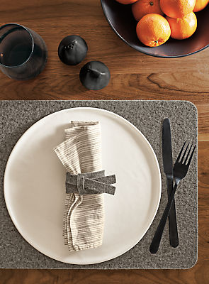 Detail of Verza felt napkin ring in place setting next to Anya bowl
