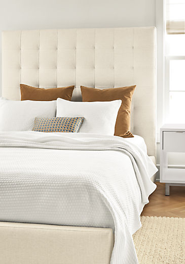 Detail of Avery queen storage bed in Sumner Ivory fabric