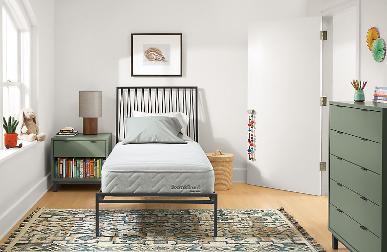 Detail of Basic twin mattress on Jennings bed in kids bedroom
