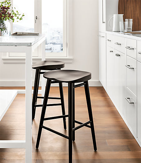Detail of 2 Bay counter stools in charcoal on cherry at kitchen counter table