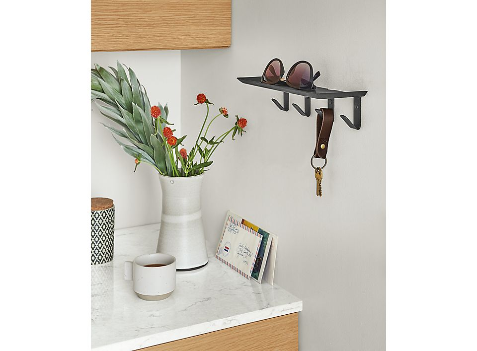 Detail of Bend wall shelf with hooks in Graphite in kitchen/entryway