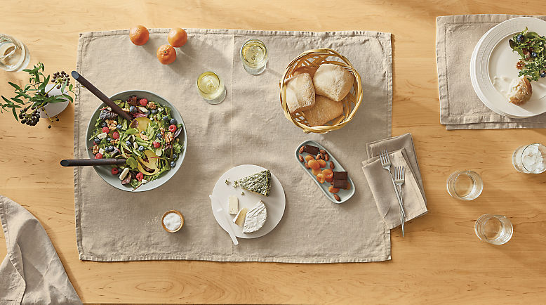 Detail of table top with Bene linens, Nadia tray, Mendota serving board, Anya bowl