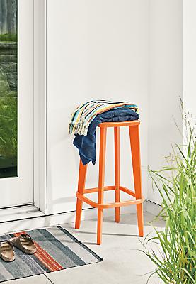 Detail of Brook bar stool in orange on patio