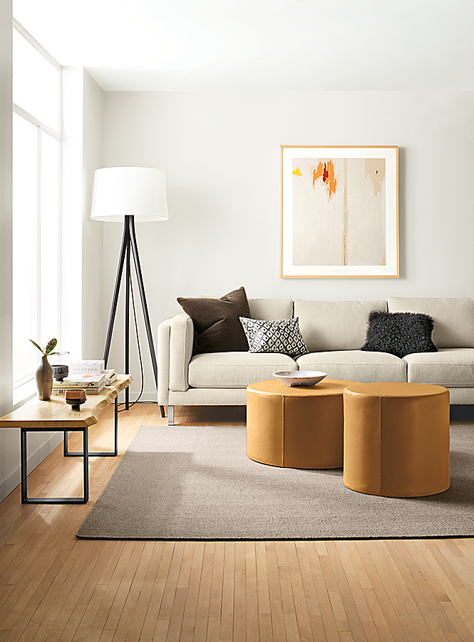 Detail of Cade sofa and leather Aero ottomans