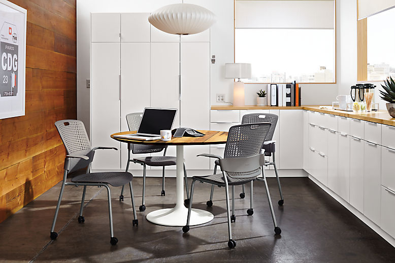 Detail of four Cinto grey office chairs in café