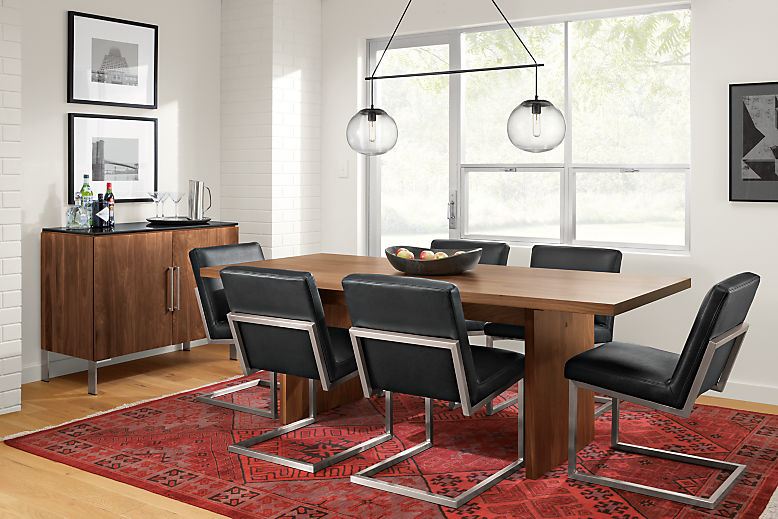 Detail of Corbett table with Lira chairs