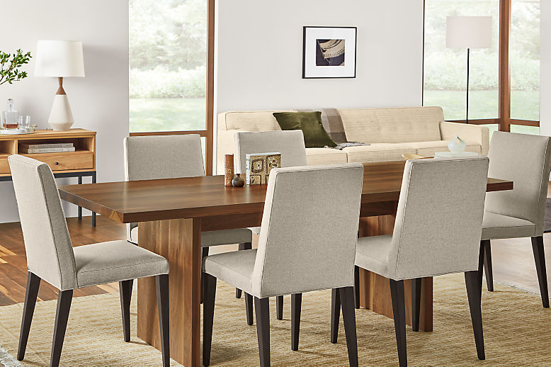 Detail of Corbett dining table in walnut in dining room with Ava side chairs