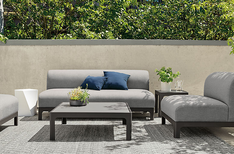 Outdoor Crescent sofa and chair on rug