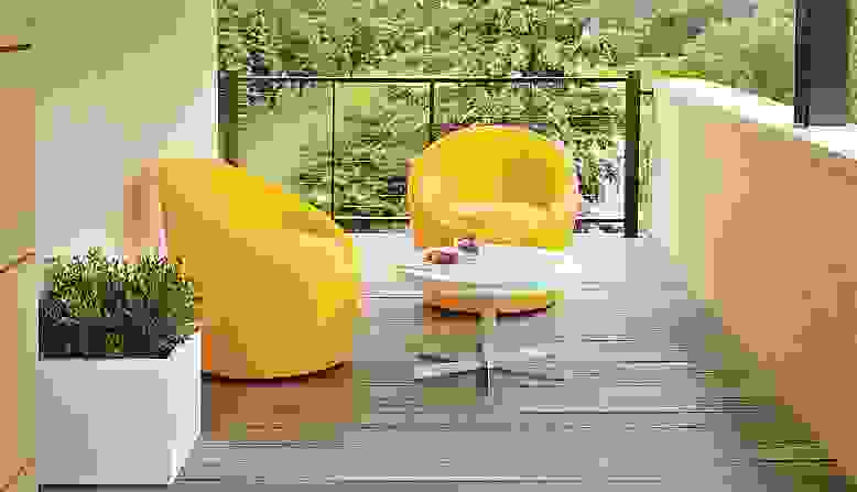 Two yellow Crest chairs on balcony