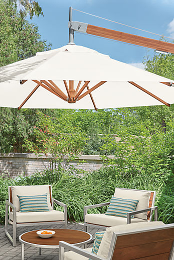 Detail of Cumulo patio umbrella above Montego chairs