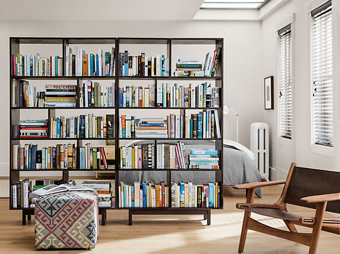 Dahl bookcases separating bedroom and living room