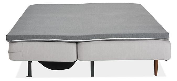 Deco armless sleeper sofa in loft