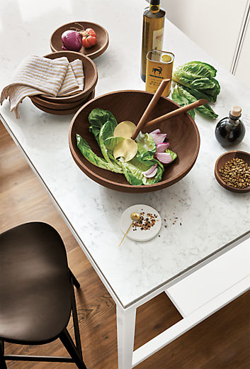 Detail of Calder bowls in walnut on kitchen counter for serving and salad tossing