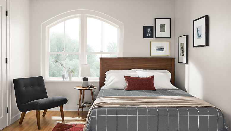 Detail of Emerson wood bed in small space