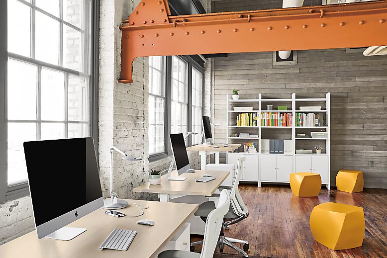 Detail of three Float desks in modern workspace