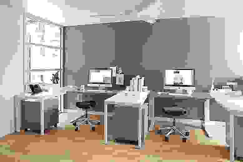 Float adjustable desks in modern office