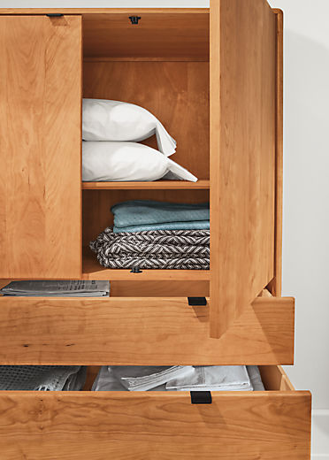 Detail of open Hensley three-drawer armoire