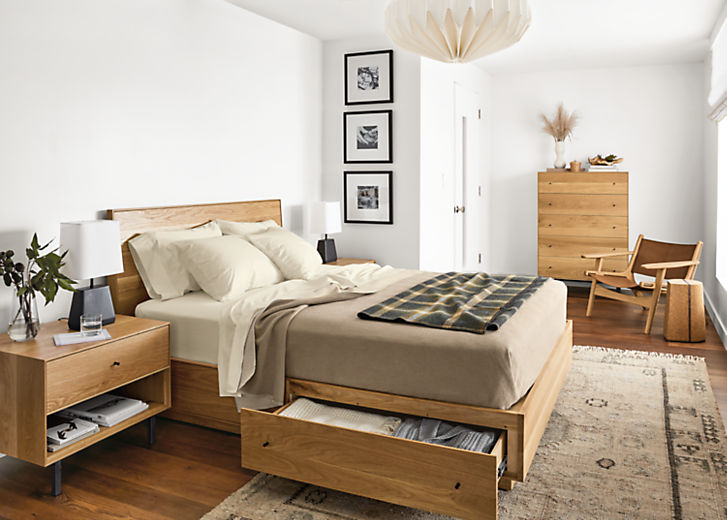 Detail of Hudson queen storage bed in white oak in bedroom with drawer open