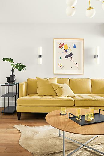 Detail of Hutton sofa in Banks Straw velvet below Malevich wall art
