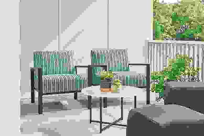 Detail of Isles outdoor lounge chairs in Vinna ocean fabric