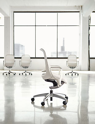 Detail of four Luce office chairs