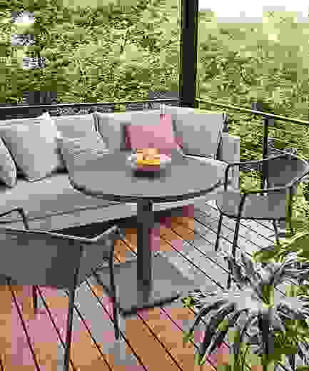 Detail of Maris outdoor round patio table and Palm sofa