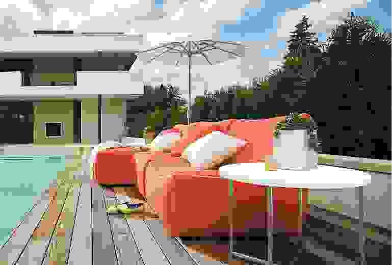 Outdoors with Maya armless chair in sunbrella canvas orange