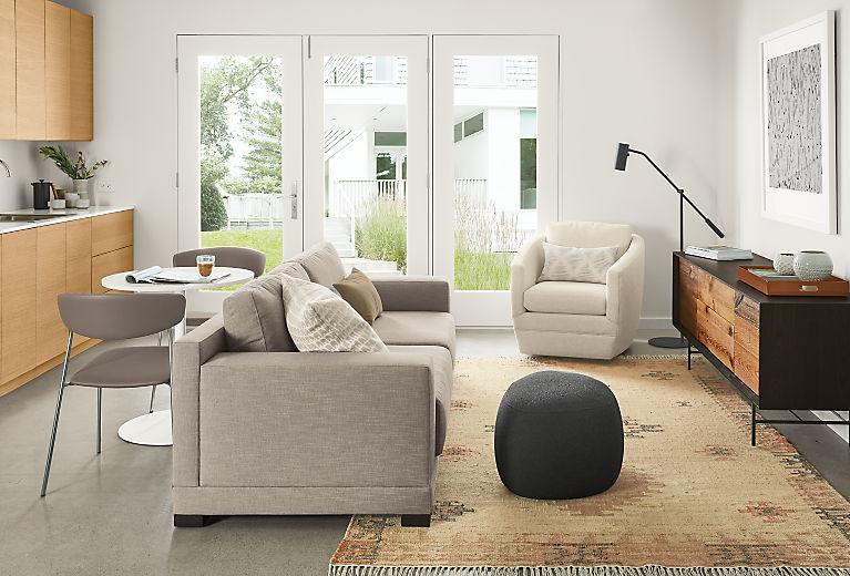 Side view of Mira sofa in Destin Putty fabric in small living/dining space