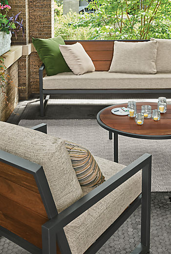 Detail of Montego outdoor sofa and lounge chair and coffee table