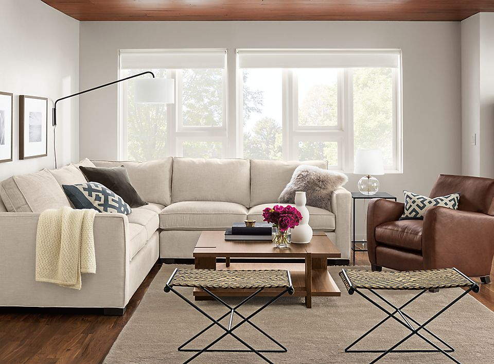 Living Room With Sofa And Stools Room Board