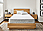 Detail of Natural organic latex & coil hybrid queen mattress in Natural style bedroom