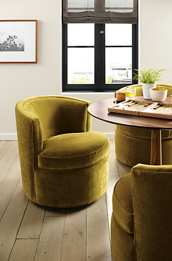 Dining room with Otis swivel chair in vance mustard