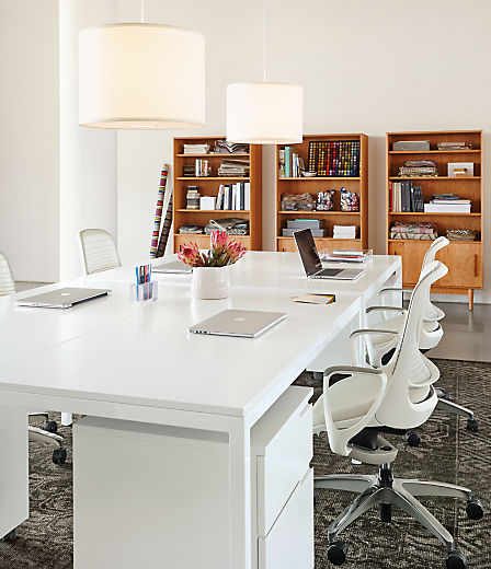 Detail of Pratt desk with white MDF top and white powder coated steel base