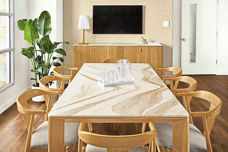 Detail of Pren dining table and console table both in white oak with Cambria Brittanica Gold tops in conference room