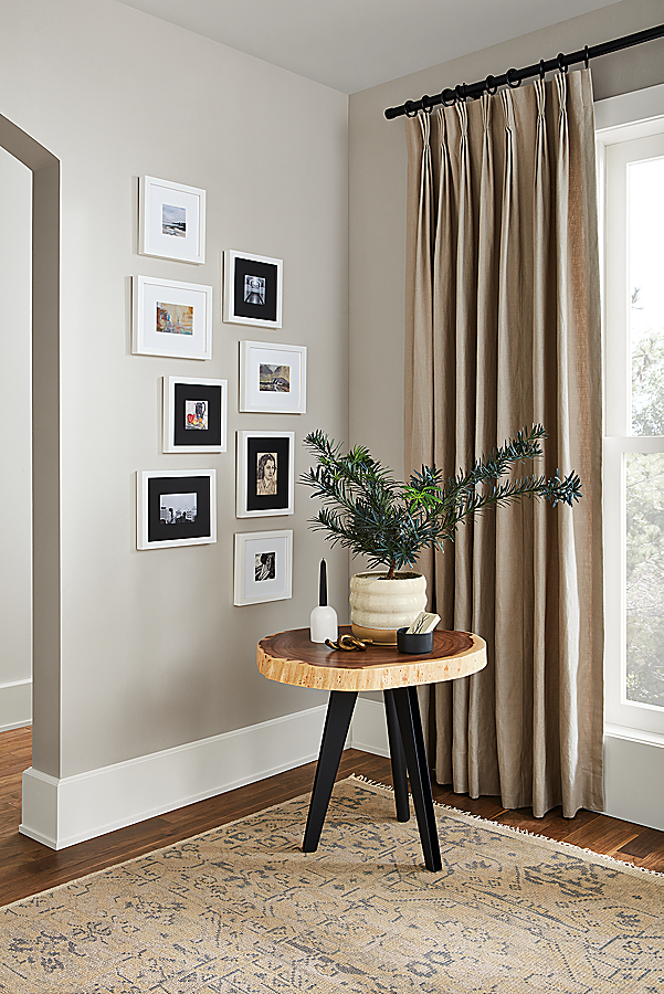 Profile Frames in White Wood Frame Wall