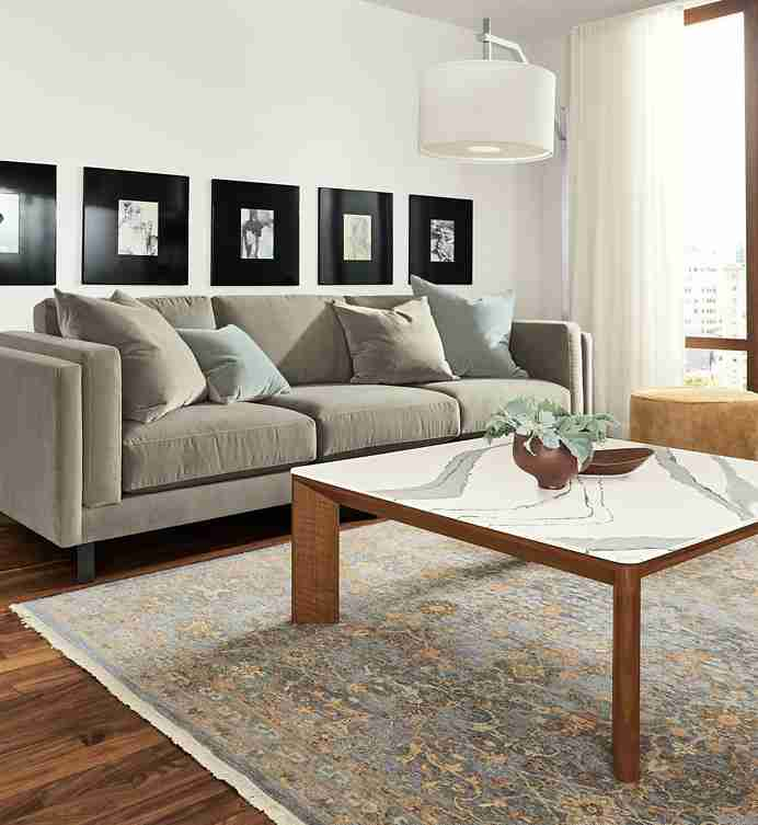 Shop this room with the Pren Coffee Table with Cambria Top in Living Room