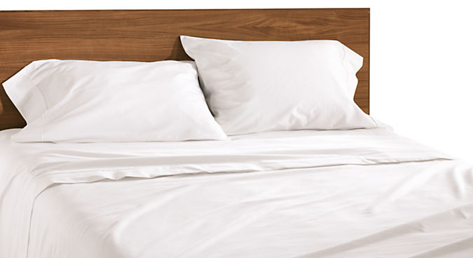 Combination of Sommerville percale queen sheet set in white with white stitching and Copenhagen queen bed