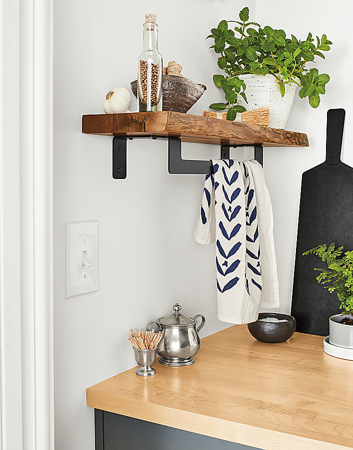 Detail of Stowe shelf with towel rack, in walnut and graphite