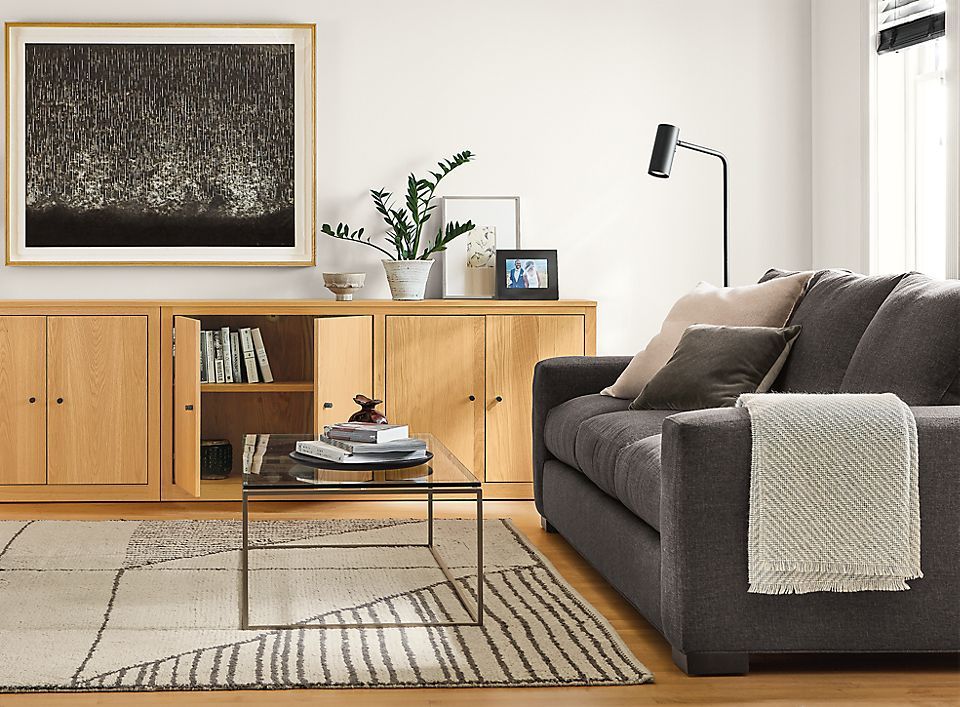 Detail of Metro sofa in living room with woodwind custom bookcases