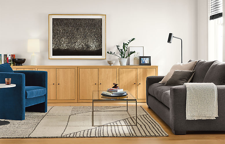 Detail of living room with Metro sofa, Silva chair and Woodwind bookcases