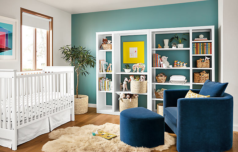 Detail of Woodwind open back bookcases in kids bedroom with Silva chair and Nest crib