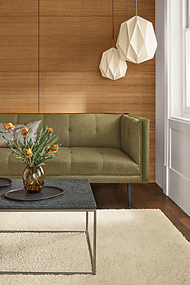 Detail of Wynwood sofa in Sumner Fern fabric and Banks Moss velvet accent in living room